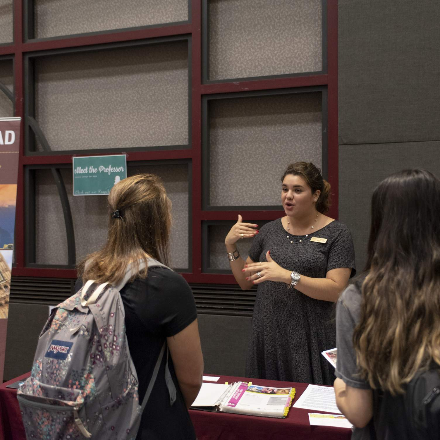 Education Abroad representative talking to students at Meet the Professor Fall 2019.
