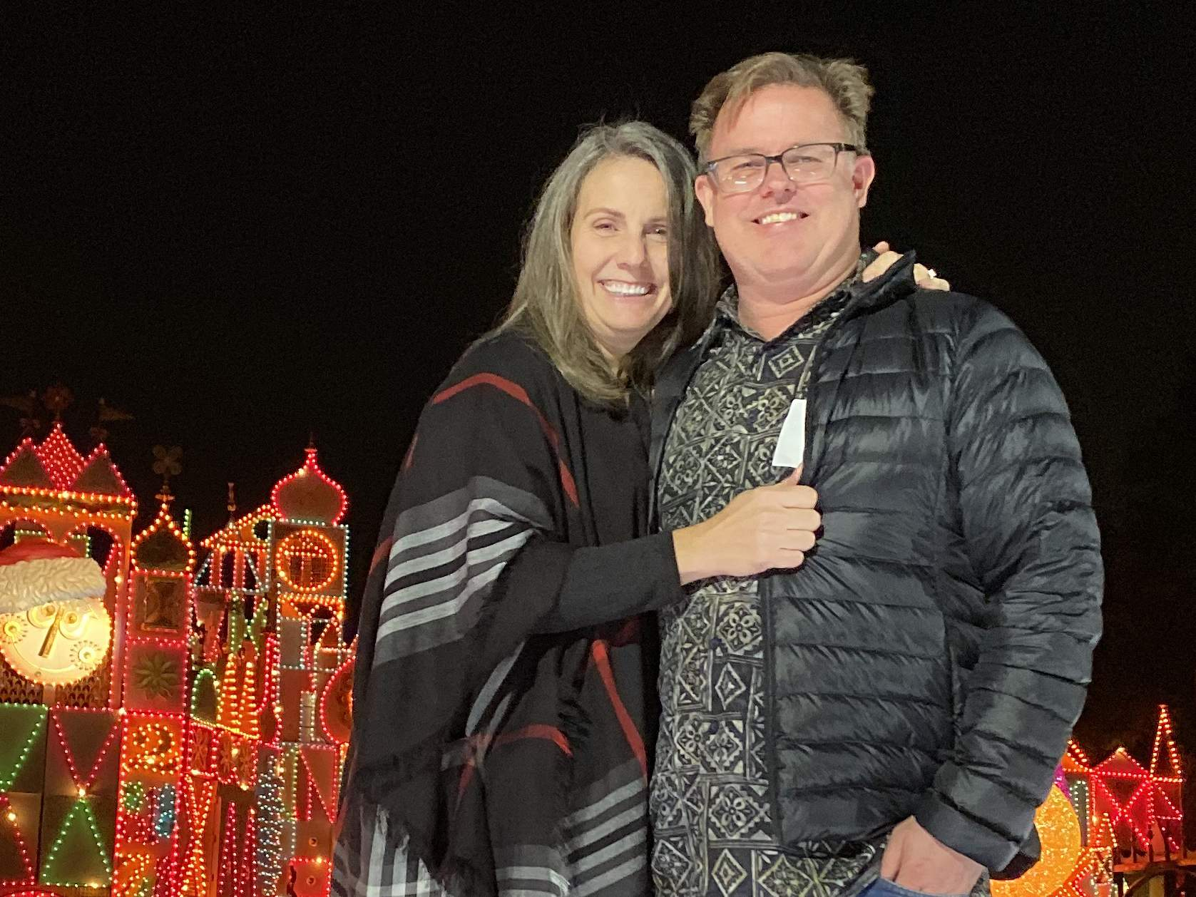 lori merkle and matt ford standing in front of light display