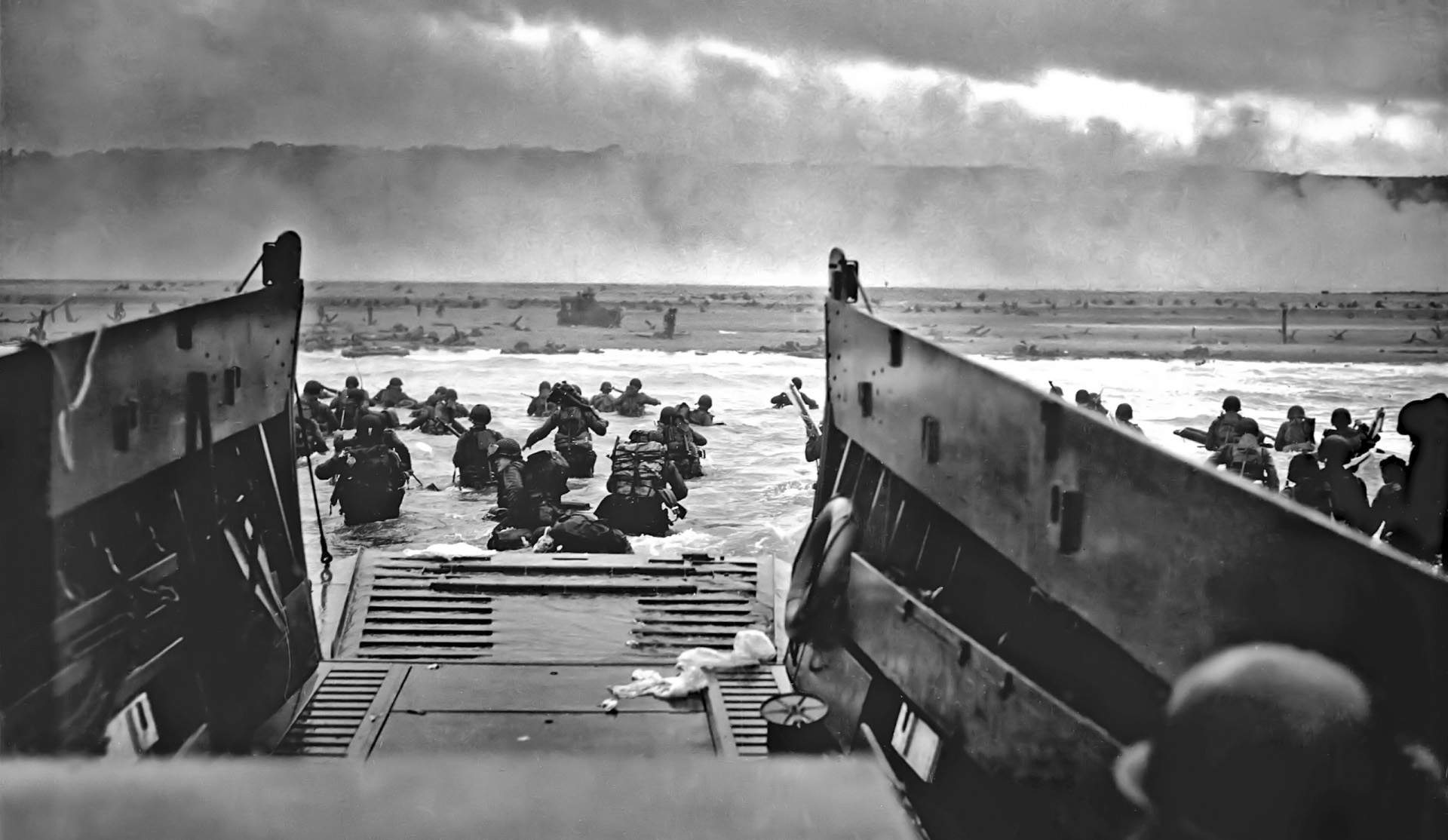 black and white photograph of soldiers on normandy beach