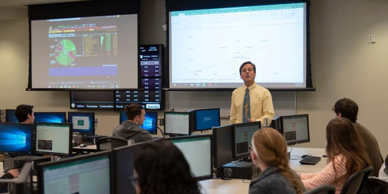 Finance professor teaching a class in the trading lab