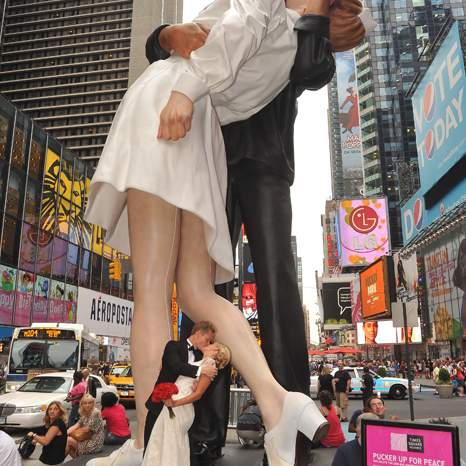 "To mark the 65th anniversary of VJ day in 2010, the Times Square Alliance brought this enormous statue of the Kiss to Times Square and invited couples to replicate the pose. For August 14, 2015, the Times Square Alliance has planned another ""Times Square Kiss-In"" to commemorate the 70th anniversary of the end of World War II. Readers can find the location of the original Kiss by going to the west side of the pedestrian island, opposite the Bubba Gump Shrimp Co. sign now on the ground floor of the Paramount Building. (Asterio Tecson)"