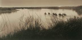 Photograph: Crossing the Rio Grande, © 1988, by Bill Wittliff