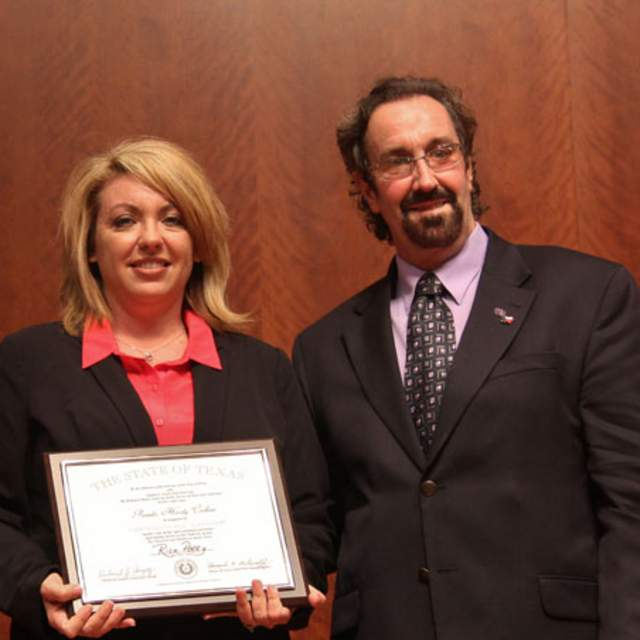 Stephen F. Austin CPM Graduate Pamela Curbow (left) with Dr. Rick Herzog, Stephen F. Austin State University CPM Director