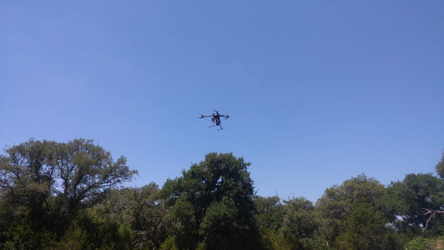 Drone in flight over the Forensic Anthropology Research Facility.
