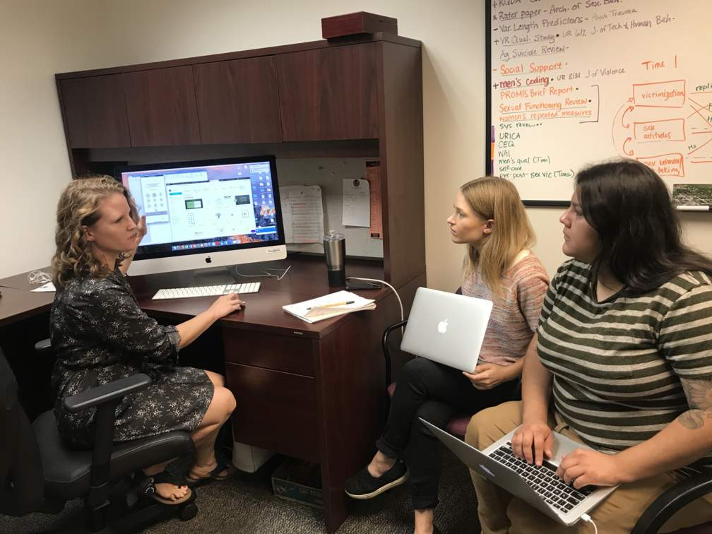 Dr. Nason (left) works with Texas State University students, Olivia Hayes (center) and Jennifer Salazar (left), to develop training materials that will be used to support the grant.