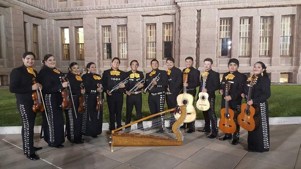 Mariachi Nueva Generacion ensemble standing outside the performing arts center.