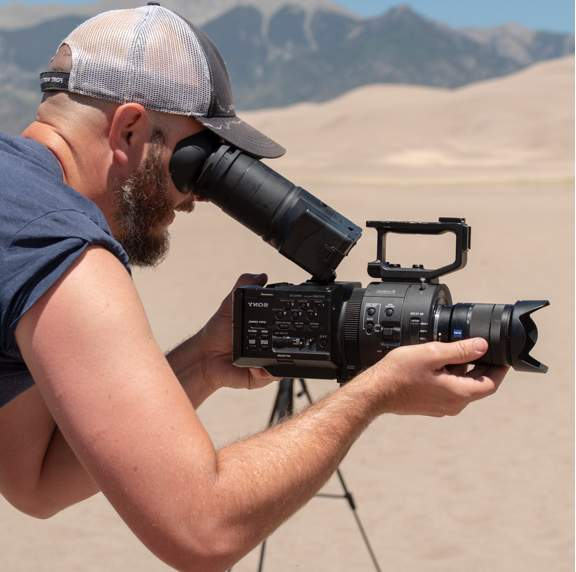videographer capturing a desert shot
