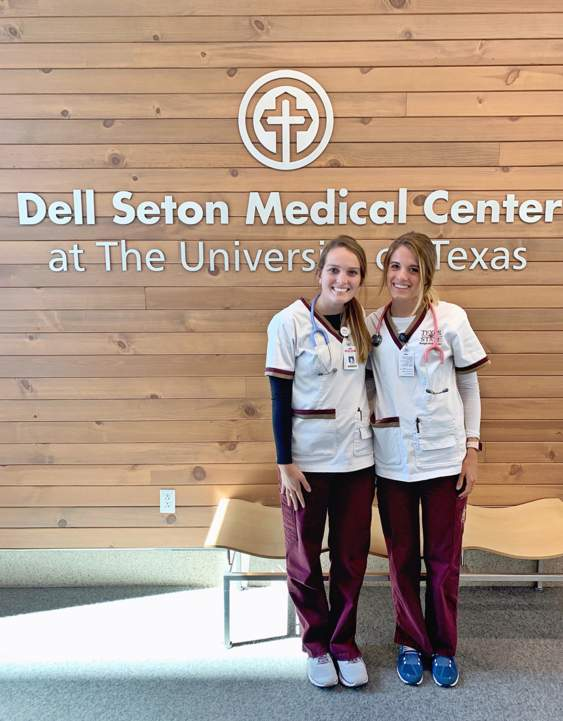 two students in front of medical center sign