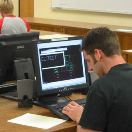 Image, student using AutoCAD.