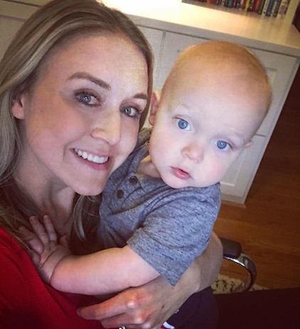 Kara Kirby and her baby at her home