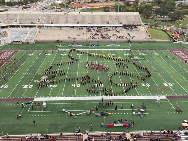 the texas state marching band forms a supercat on the football field