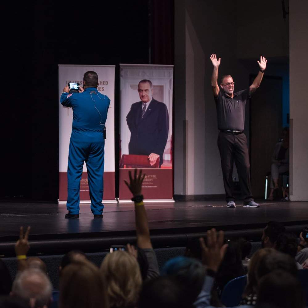 Astronaut José Hernández takes a selfie with the crowd at Evans Auditorium