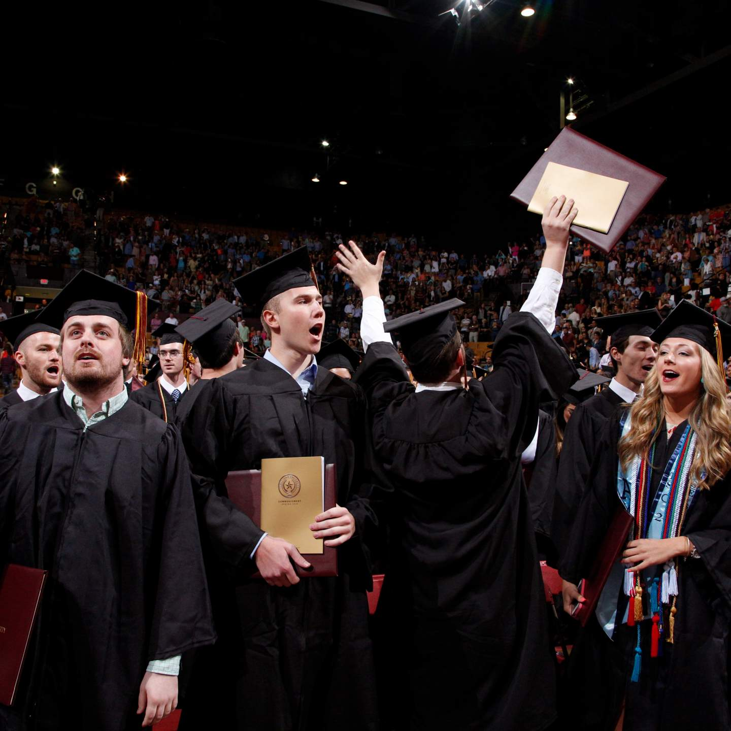 Newly conferred graduates celebrate at the end of a Spring 2016 Texas State University commencement ceremony.
