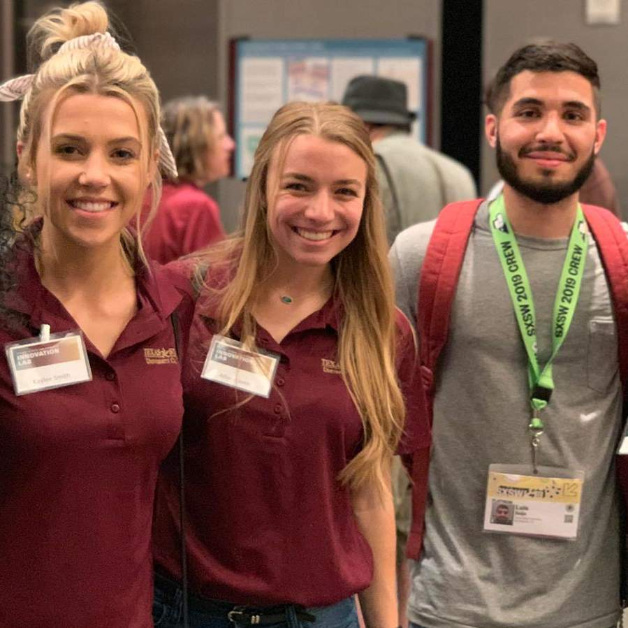 Student digital media teams mingling and smiling at TXST Innovation Lab event