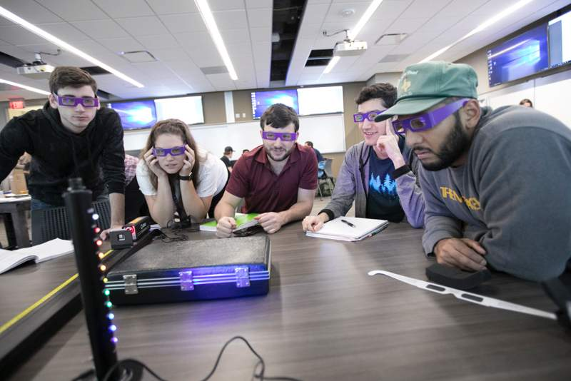 students solving problems with special glasses