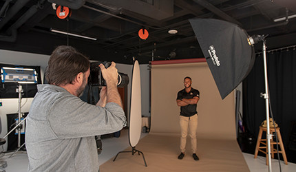 man taking a photo in a studio
