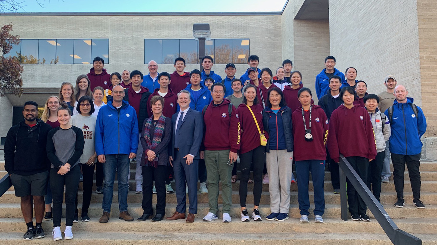College of Education faculty and graduate students pose with members of the Chinese Olympic Rowing Team