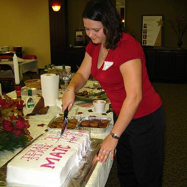 Melissa Boettcher cuts the cake