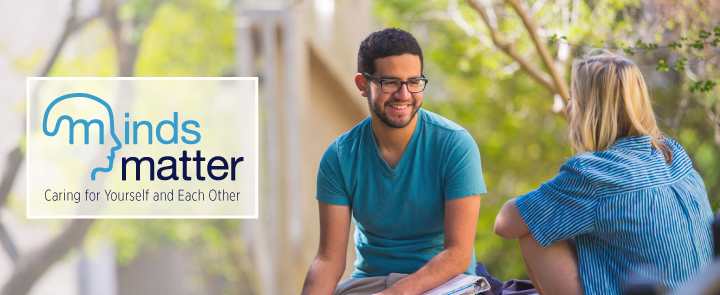 Minds Matter homepage banner with two students talking to eachother.
