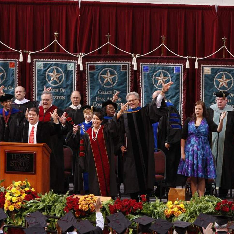 "Faculty does ""The Heart of Texas State Hand Sign"""