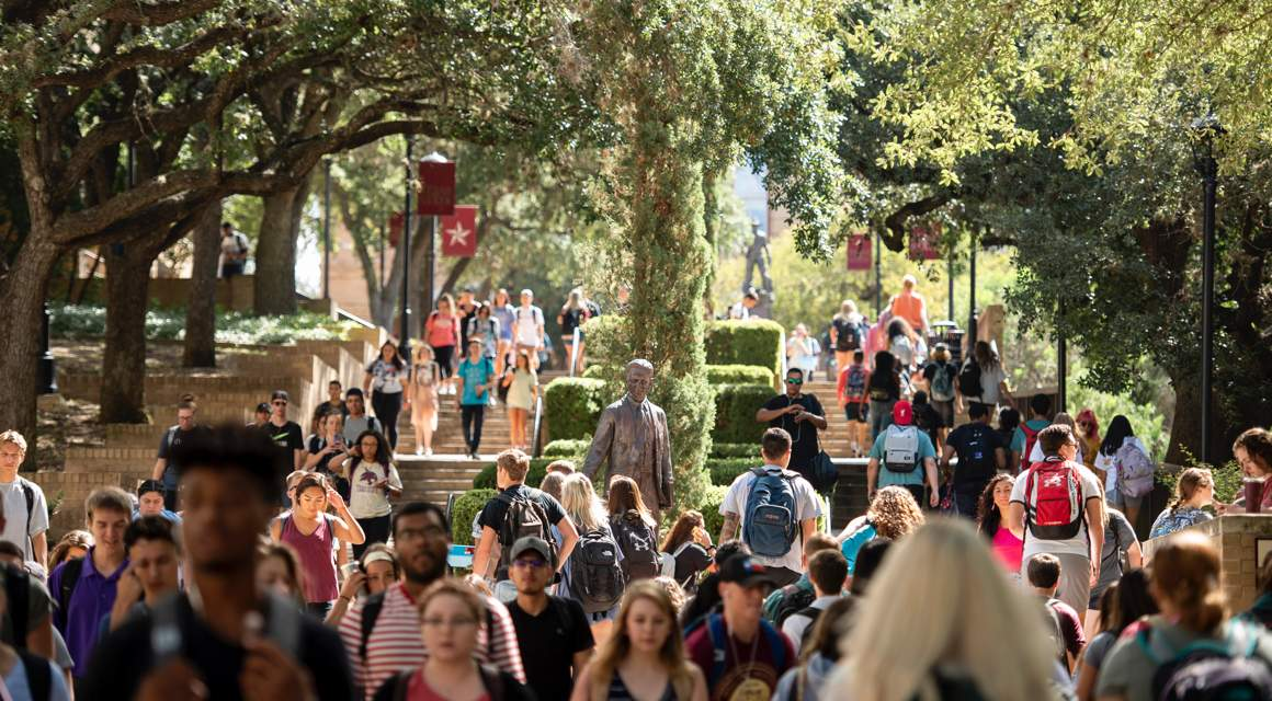 students walking near the LBJ monument