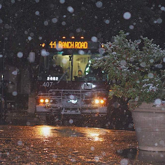 texas state bus parked in snow