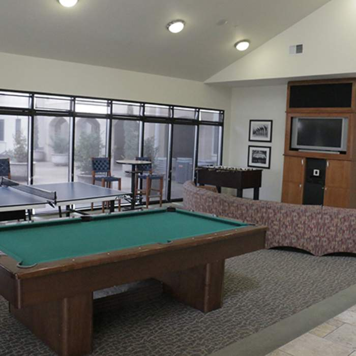 San Jacinto Hall lobby with TV, couches and a pool table