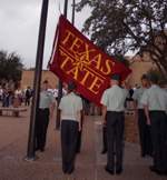 Students raising Texas State flag