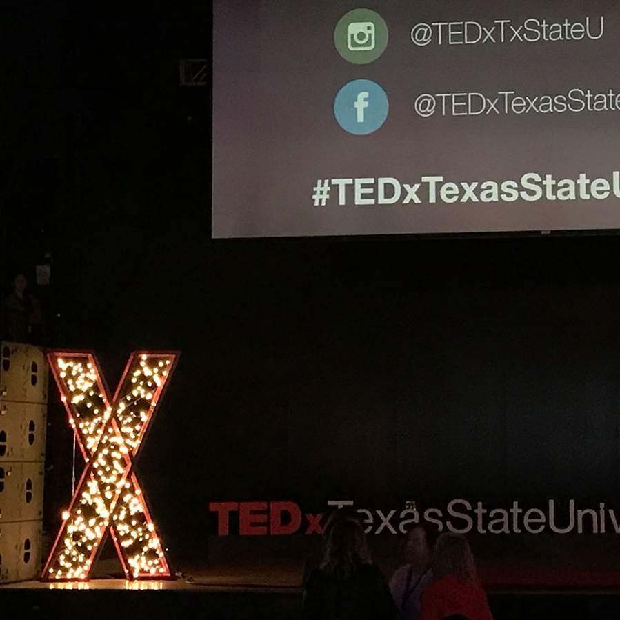 TEDx stage with illuminated X