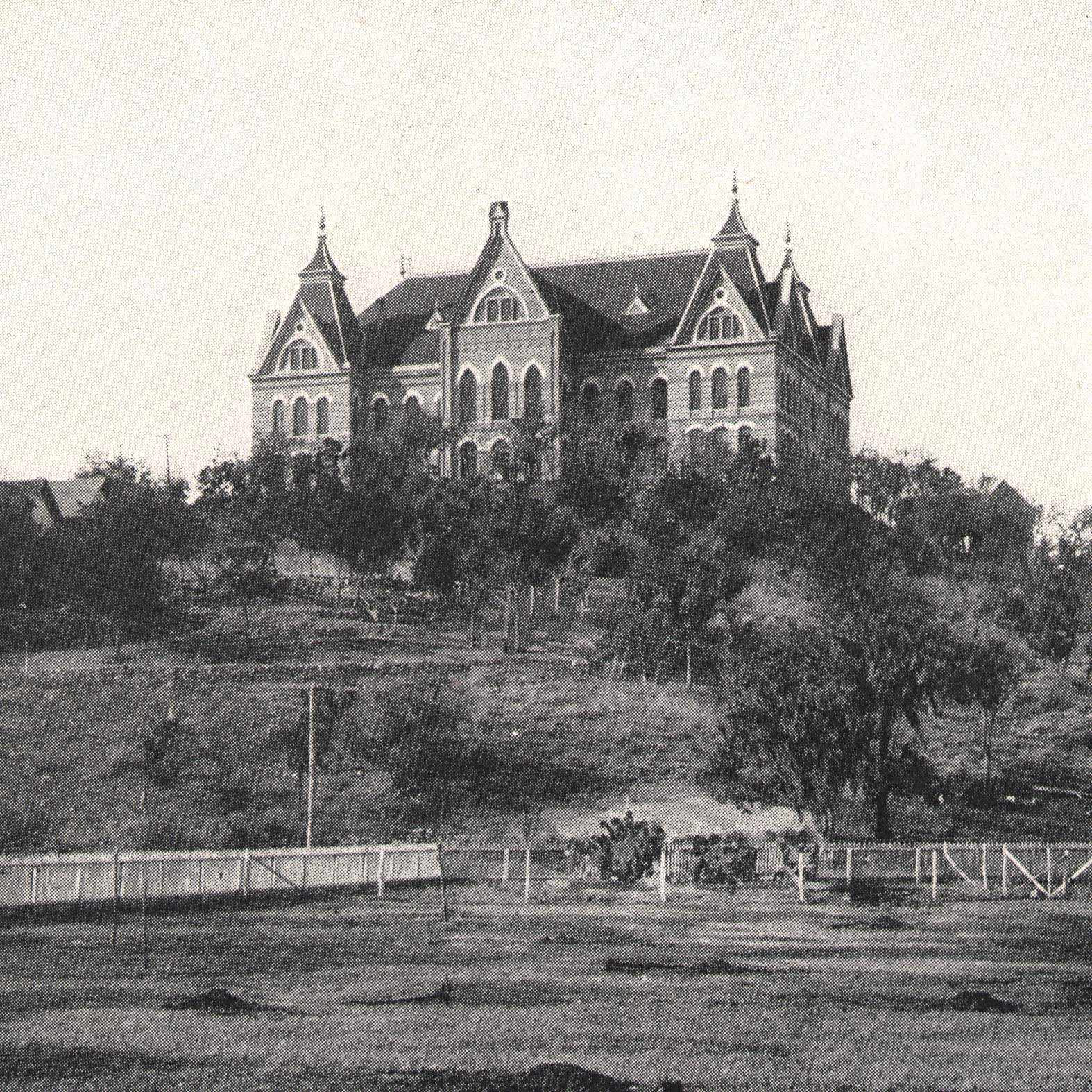 early 1900's image of Old Main at the top of the hill