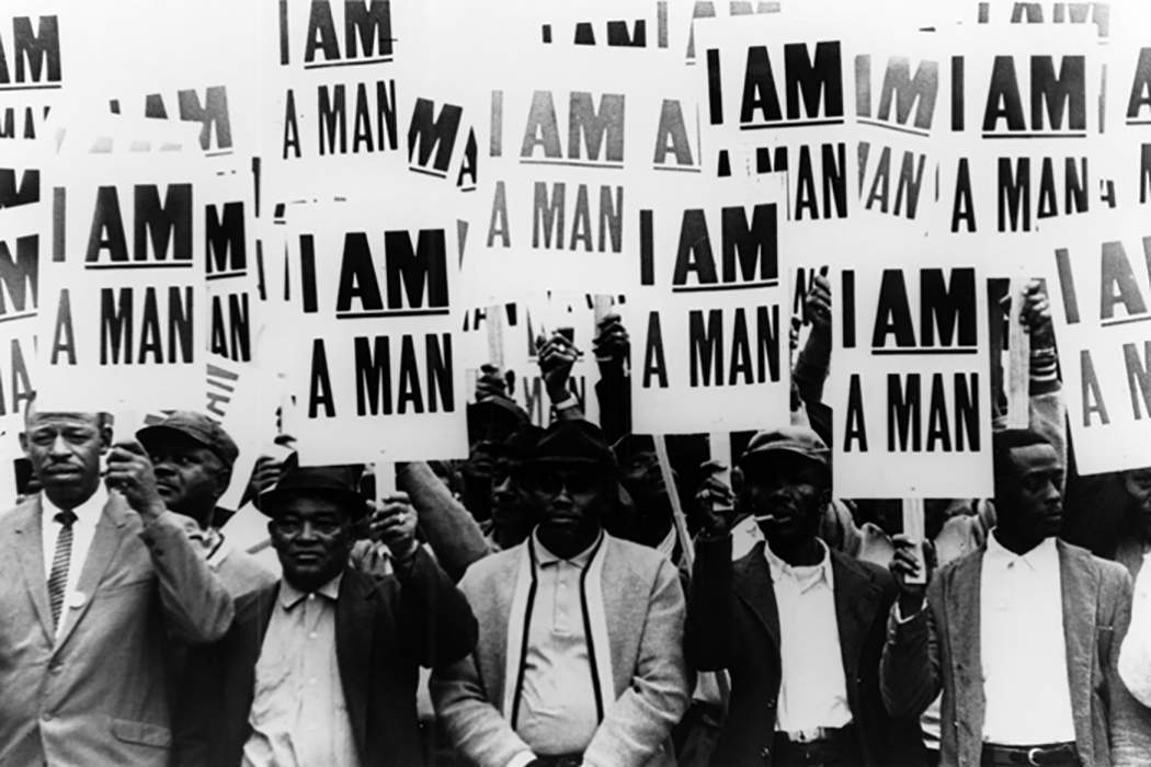 men holding signs reading i am a man