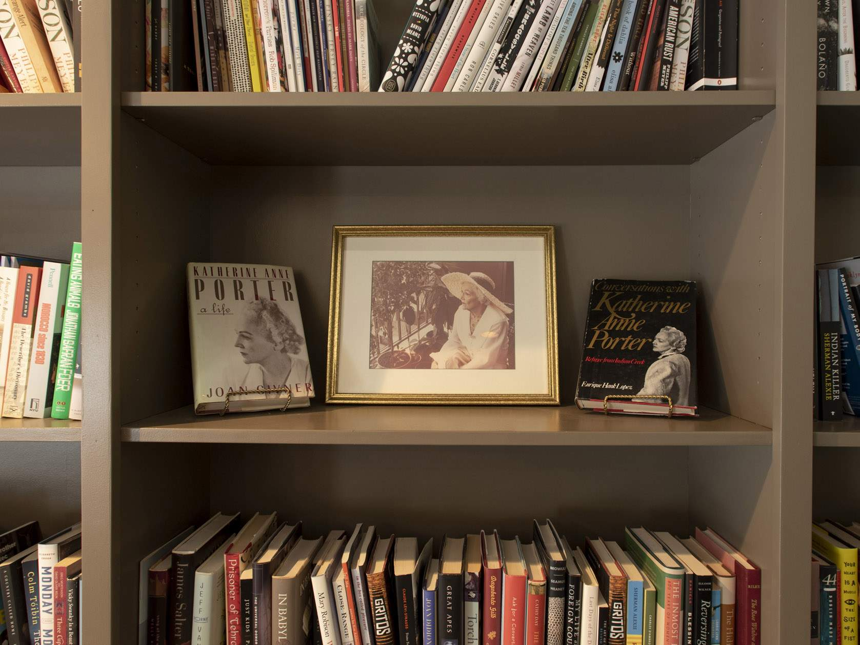 frame of katherine anne porter on bookshelf